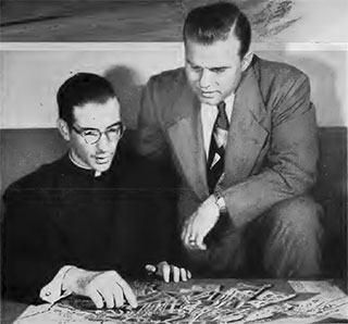 Father Schiffer and Robert Lewis study a map of Hiroshima brought from Japan by the priest who, at the time of the blast, was only eight blocks from its center.