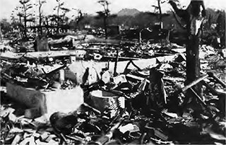 This is what the A-bomb did to that part of Hiroshima in which Father Schiffer lived. In the foreground can be seen the ruins of the Assumption of Our Lady Church.